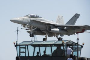 160511-N-BB269-074 IWO TO, Japan (May 11, 2016) An F/A-18E Super Hornet, attached to the Diamondbacks of Strike Fighter Squadron (VFA) 102, assigned to Carrier Air Wing (CVW) 5, practices a touch-and-go landing during field carrier landing practice at Iwo To, Japan. Formerly known as Iwo Jima, Iwo To is an island roughly 750 miles south of Tokyo used by CVW 5 to conduct yearly fighter pilot training and qualifications. (U.S. Navy photo by Mass Communication Specialist 2nd Class Raymond D. Diaz III/Released)